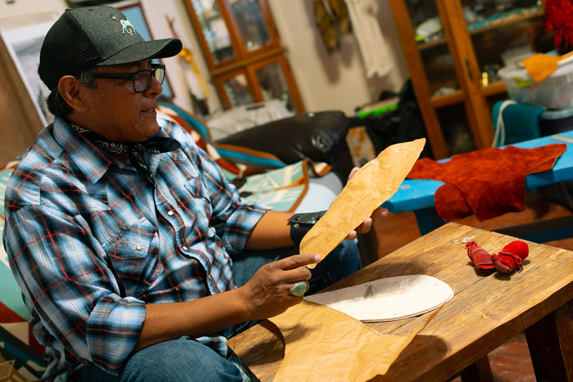 Brent with a foot-tracing he'll use to construct a pair of custom-fit moccasins. JAKE HOYUNGOWA