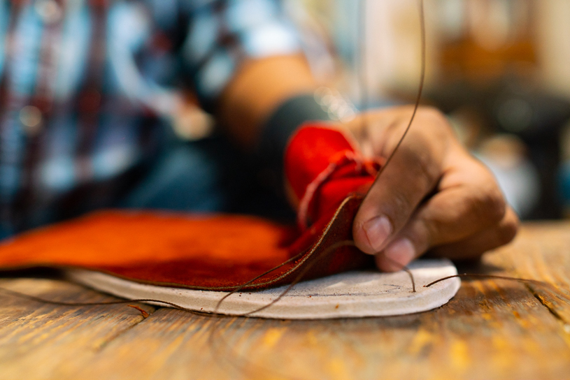 Brent sewing a pair of custom-made moccasins. JAKE HOYUNGOWA
