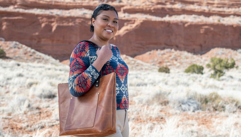 Summer Brown shows off a Lotus & Layne handcrafted tote. Photo by Deidra Peaches