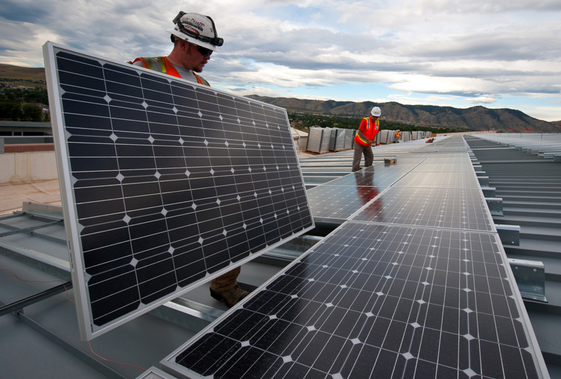 Workers install solar panels on a roof in Golden, Colorado. Photo by Dennis Schroeder courtesy of Department of Energy