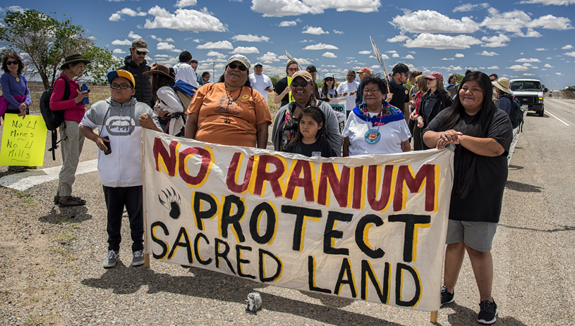 White Mesa Concerned Community members lead a spiritual walk to the mill. TIM PETERSON