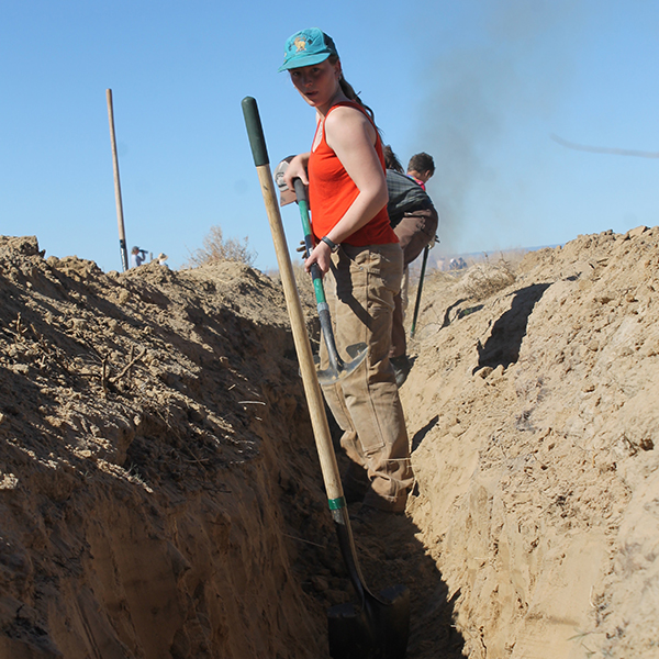 Digging irrigation ditch