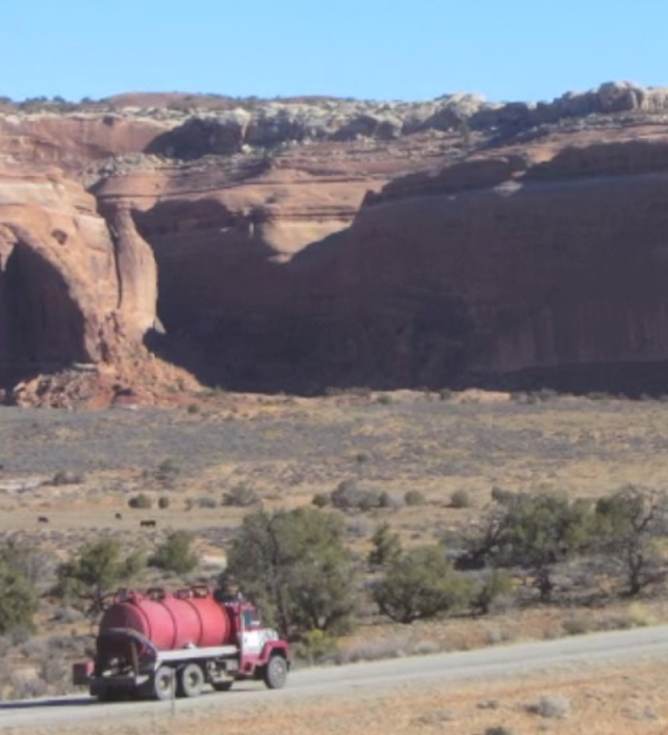Greater Canyonlands - Oil field truck traffic outside Canyonlands National Park